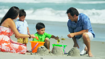 stock-footage-loving-hispanic-family-spending-summer-vacation-playing-on-sandy-beach-shot-on-red-epic